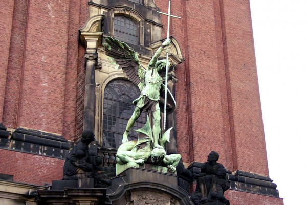 A sculpture of an angel warring with a demon at a church in Hamburg, Germany. (Photo by Alvaro Guzman)