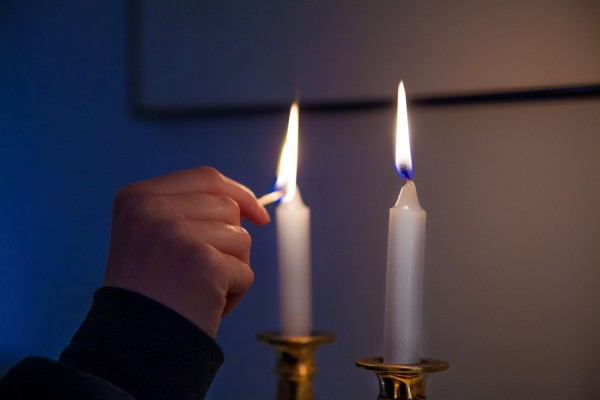 On Friday night, it is customary to kindle Shabbat candles just before the arrival of the Sabbath. (Photo by Robert Couse-Baker)