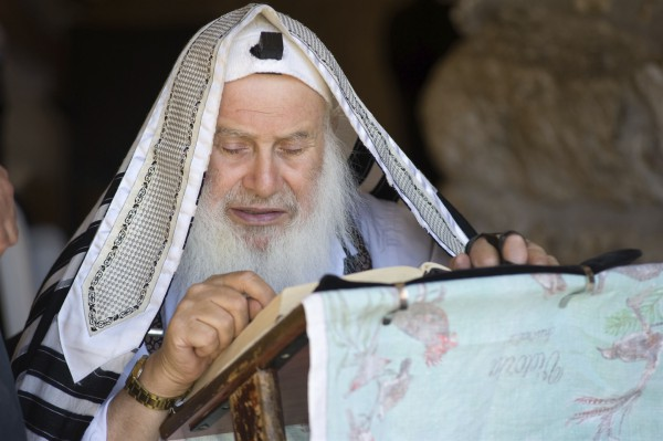 A Jewish man prays at the Kotel (Western Wall) in Jerusalem.