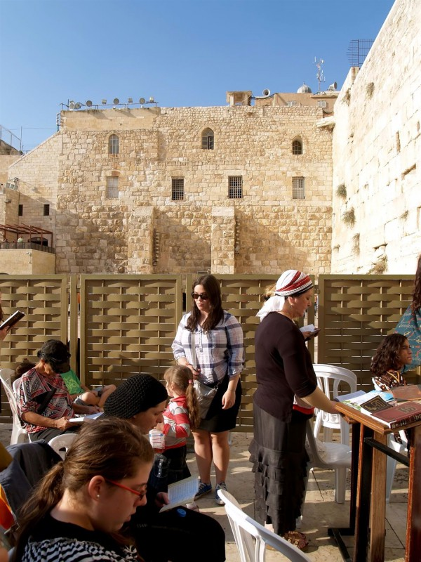 Women pray in the Women's Section of the Western Wall.