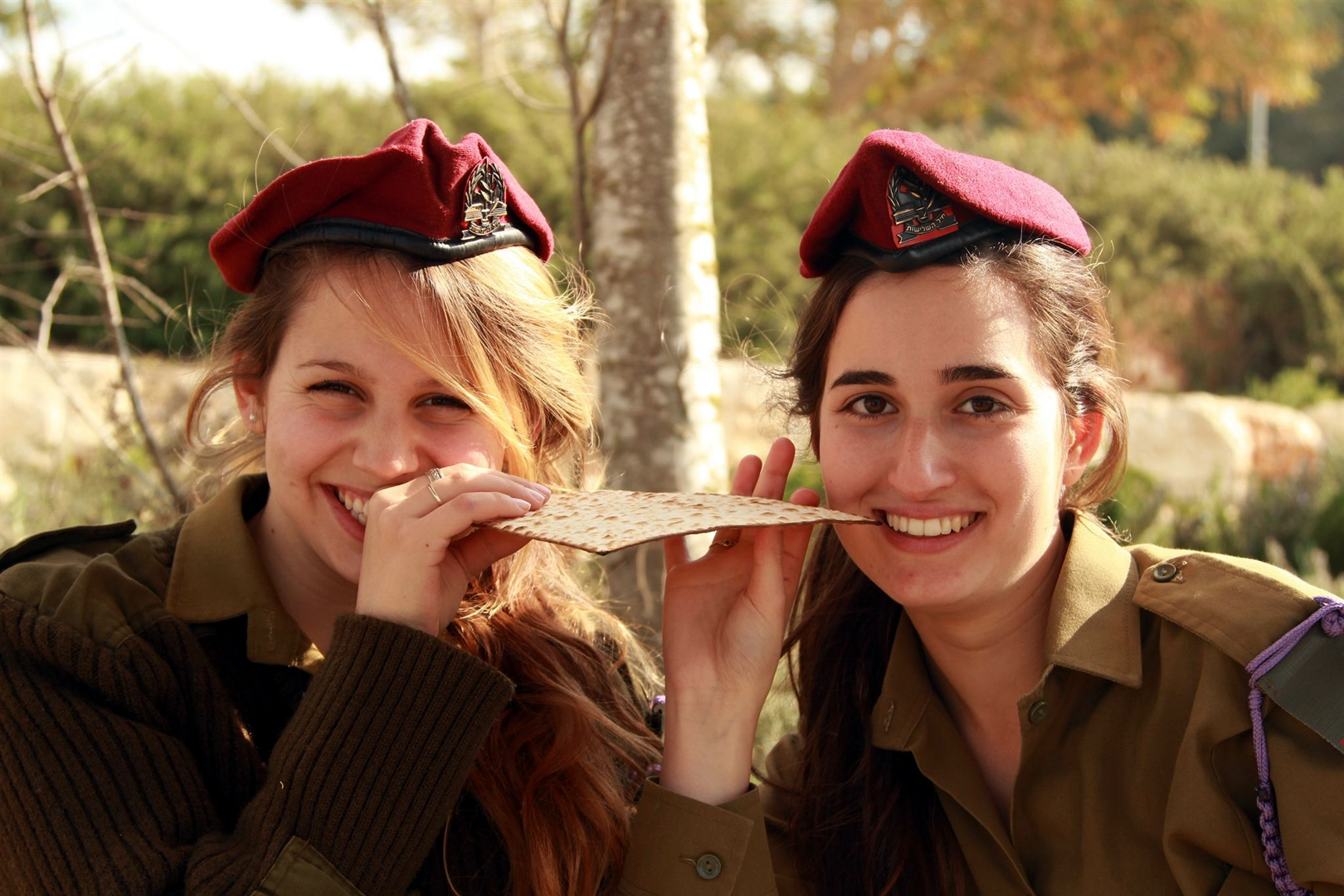 Israel Defense Forces soldiers pose with a piece of matzah in the field.  (IDF photo)