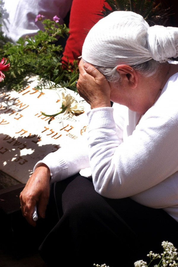 An Israeli woman grieves the loss of a loved one-Yom HaZikaron
