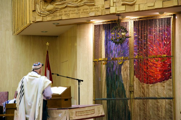 Leading the prayers from the bimah (podium) in a synagogue in Canada.
