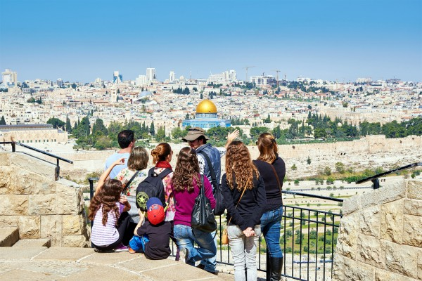 Tourists on the Mount of Olives look toward the Temple Mount where the First and Second Jewish Temples once stood. Currently the Muslim Dome of the Rock stands on the spot where they were located.