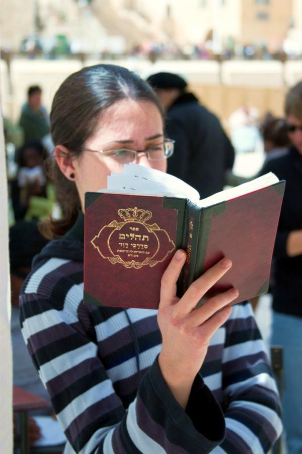 A Jewish woman reads the Psalms in Jerusalem.