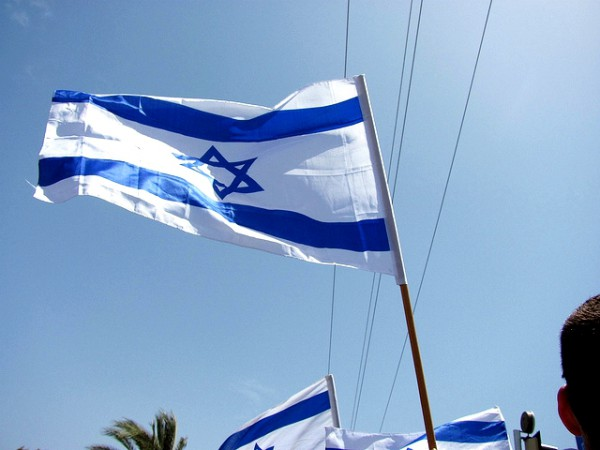 The Israeli flag is held high in celebration of the rebirth of Israel,