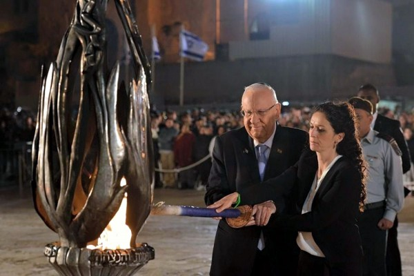 Israeli President Reuven Rivlin lights the official Yom HaZikaron torch on Memorial Day.