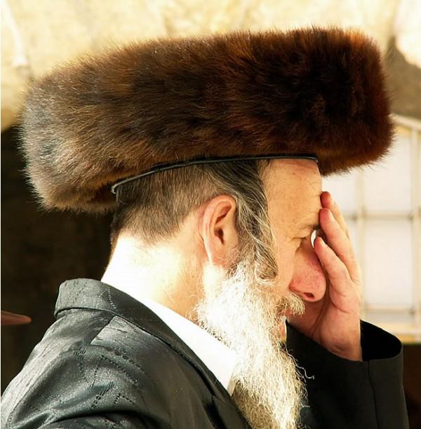 An Orthodox Jewish man wearing a shtreimel prays at the Western (Wailing) Wall in Jerusalem.