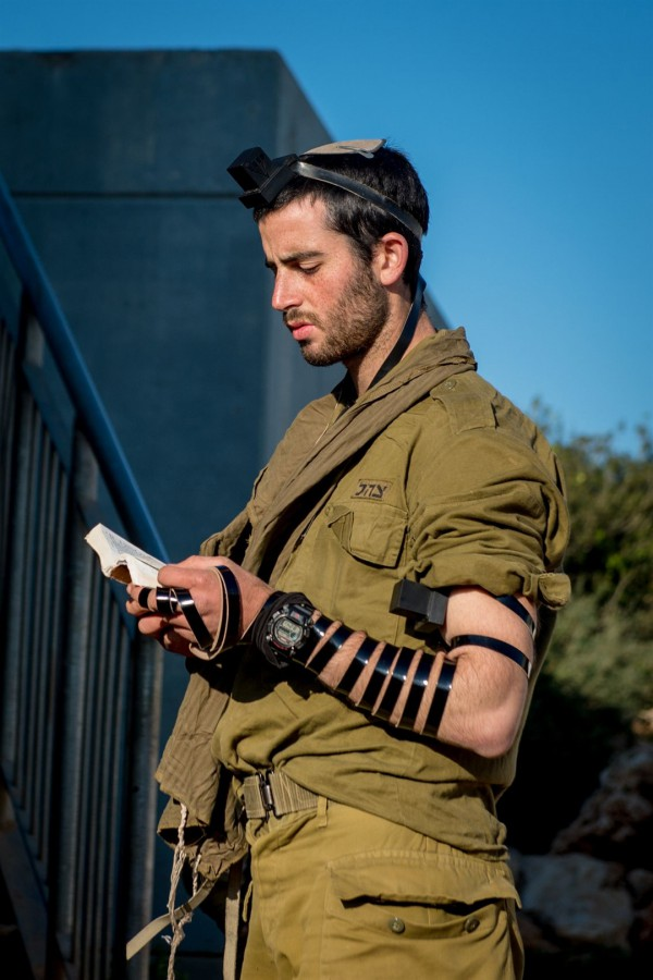 An Israeli soldier wearing tefillin (phylacteries) recites the morning prayers.
