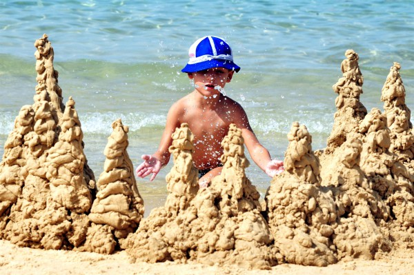 An Israeli boy makes sandcastles on the Mediterranean Sea.