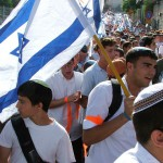 Israelis carry flags through the streets of Jerusalem.