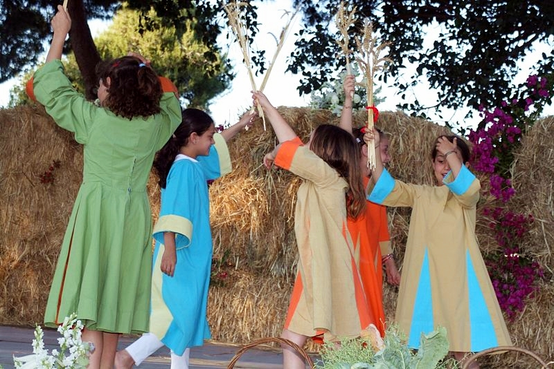 Israeli girls holding wheat perform a special dance on Shavuot.