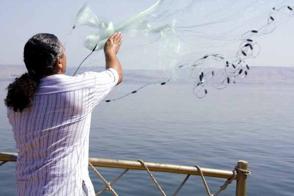Casting nets on the Sea of Galilee (Photo by Israel Tourism)