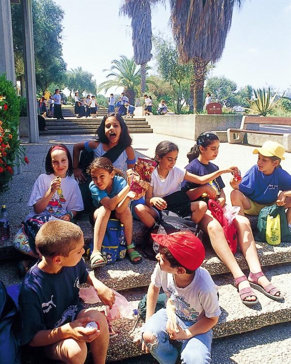 Israeli school children take a break during a school field trip.