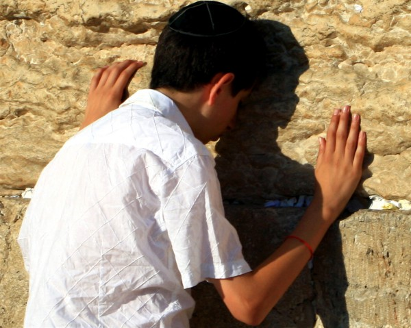 A Jewish boy prays at the Western (Wailing) Wall.
