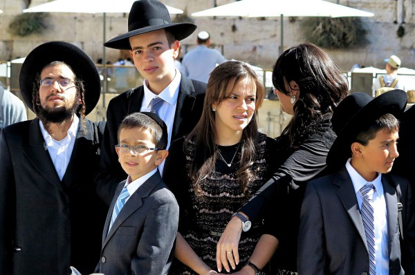 An Israeli Orthodox family at the Western Wall in Jerusalem. (Photo by Reinhardt Konig)