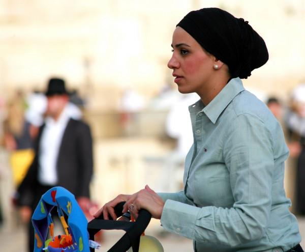Jewish mother pushes a stroller in Jerusalem. (Photo by opalpeterliu)