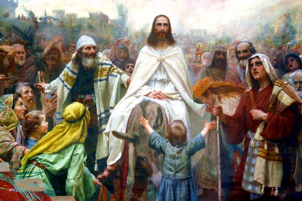 Yeshua enters Jerusalem on a donkey.