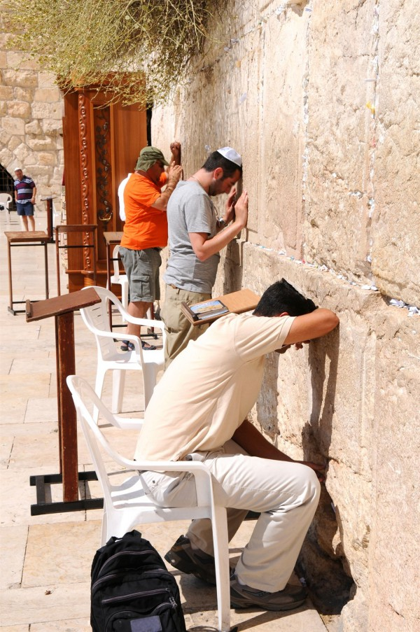 Jewish men pray at Jerusalem's Western Wall.