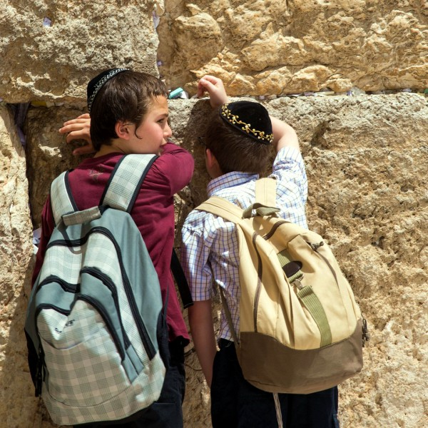 Jewish boys pray at the Western (Wailing) Wall in Jerusalem.