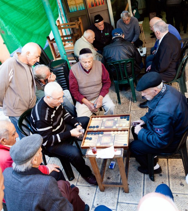 Jewish men play backgammon in Jerusalem's Mahane Yehuda Market.
