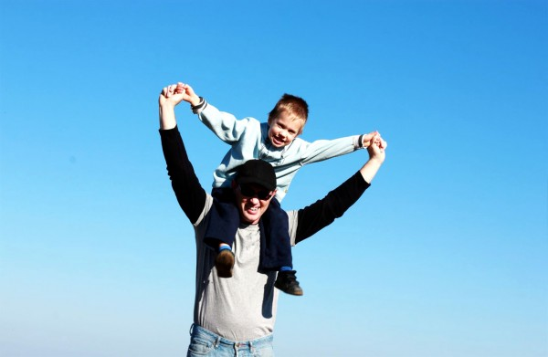 A father gives his son a ride on his shoulders during a hike in Israel.