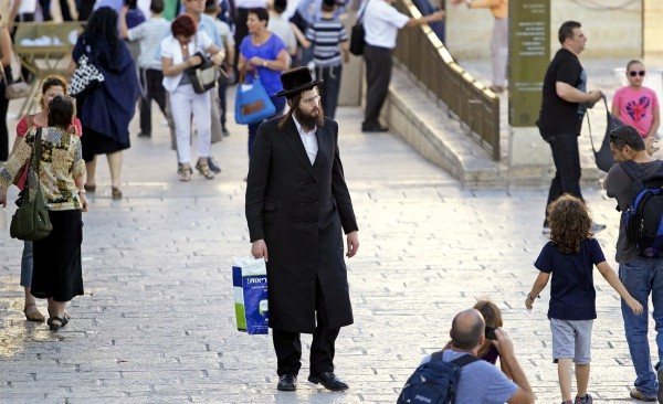 An ultra-Orthodox Jewish man on his way to pray at the Western (Wailing) Wall in Jerusalem.