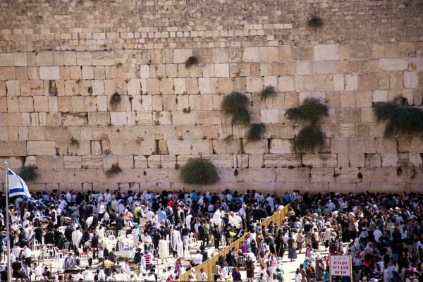 The men's (left) and women's (right) sections at the Western (Wailing) Wall in Jerusalem. Jewish people consider this site the holiest accessible site in Judaism. Above it is the Temple Mount, the holiest site in Judaism because on it the First and Second Temples once stood; however, it is not accessible for Jewish prayer.