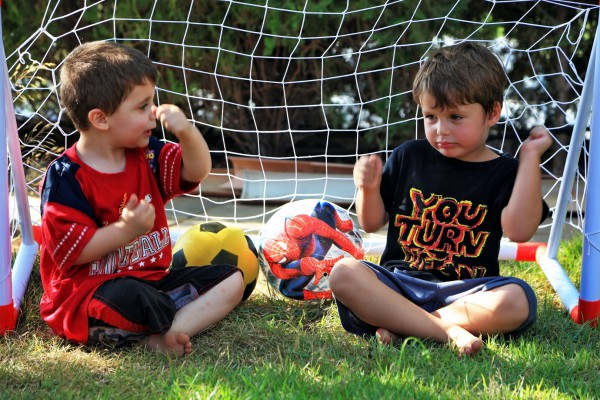 Two four-year-old Israeli boys discuss football (soccer).