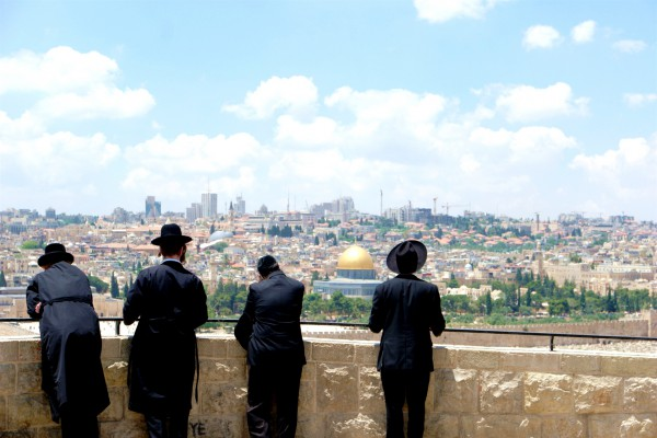 Orthodox Jewish men look toward Jerusalem and the Temple Mount from the Mount of Olives.
