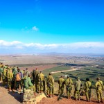 Israeli paratroopers study their positions from Mount Bental in the Golan Heights along the Israeli-Syrian border.