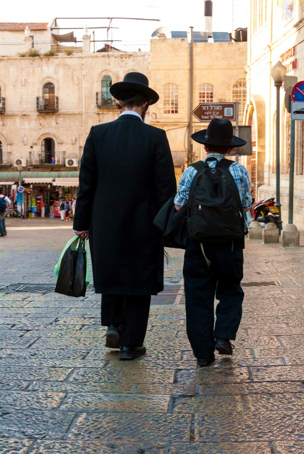 Father and son walk together in Jerusalem