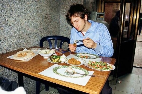 A Jewish man eats falafel in Israel.