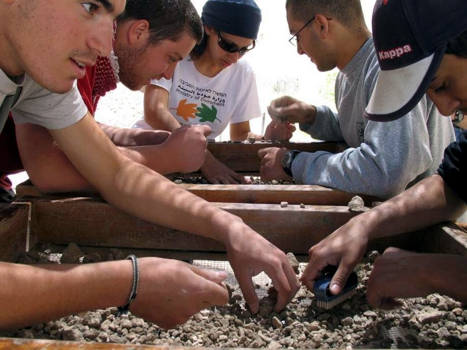Volunteers sift through debris irresponsibly excavated from the Temple Mount.  (Photo by Zachi Dvira)