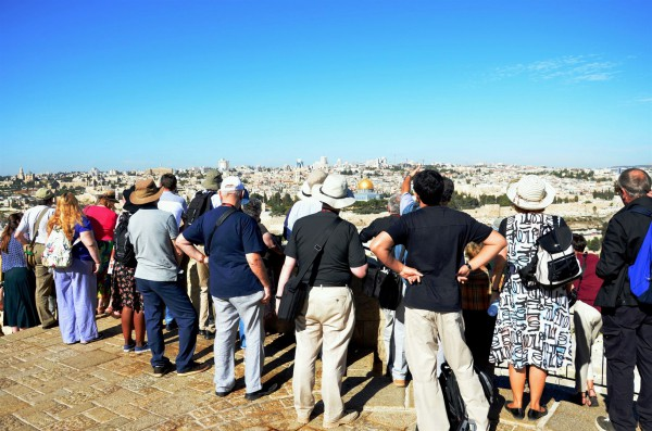 Tourists on the Mount of Olives look toward Jerusalem. (Photo by Michael Jones)