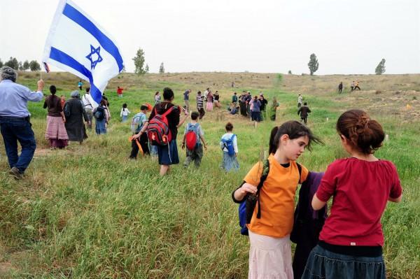 Israeli children plant trees on Tu B'Shvat.
