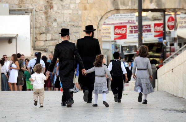 A Jewish family walks together in Jerusalem.