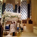A Jewish man and woman exchange wedding vows under the chuppah. (Photo by Brett Lidder)