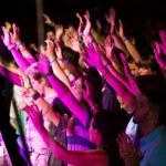 Jewish and Arab Believers raise their hands to worship the God of Israel together at the Elav Conference.
