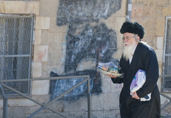 Orthodox Jewish man delivers gifts on Purim in the Mea Shearim neighborhood of Jerusalem.