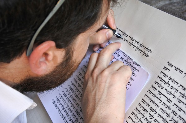 Scribe writing a Sefer Torah (Torah scroll)