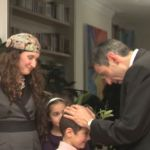 A father blesses his son at home on Friday evening.  (YouTube capture)