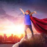 boy in cape pretending to be superhero