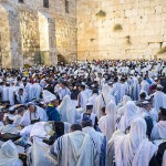 Jewish men gather at the Western (Wailing) Wall for prayer.