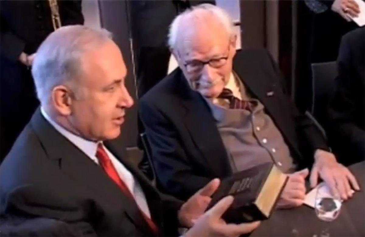 In 2012, Prime Minister Benjamin Netanyahu presented Johan van Hulst with a Hebrew Bible and appreciation on behalf of Israel for saving Jewish lives.  <em>(CIDITV YouTube Capture)</em>